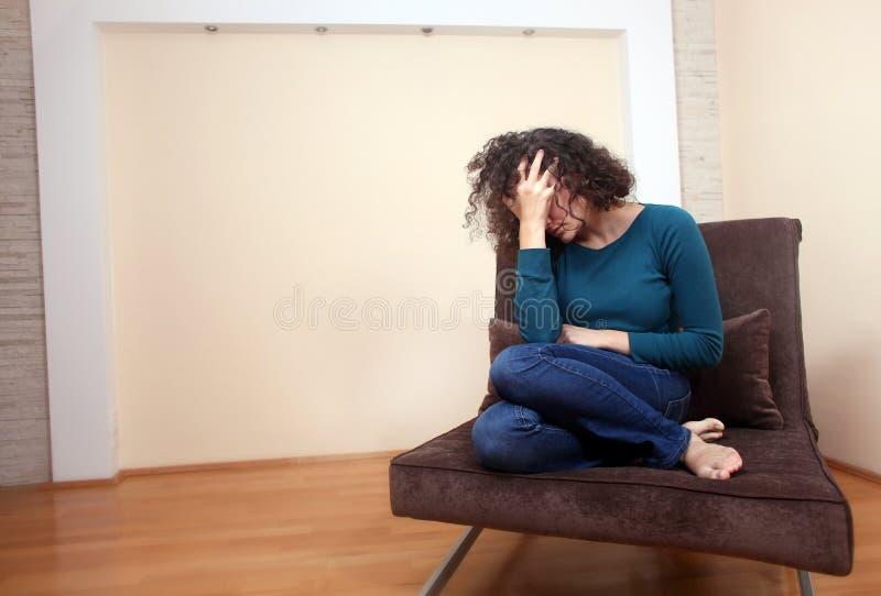 Une femme déprimée image stock