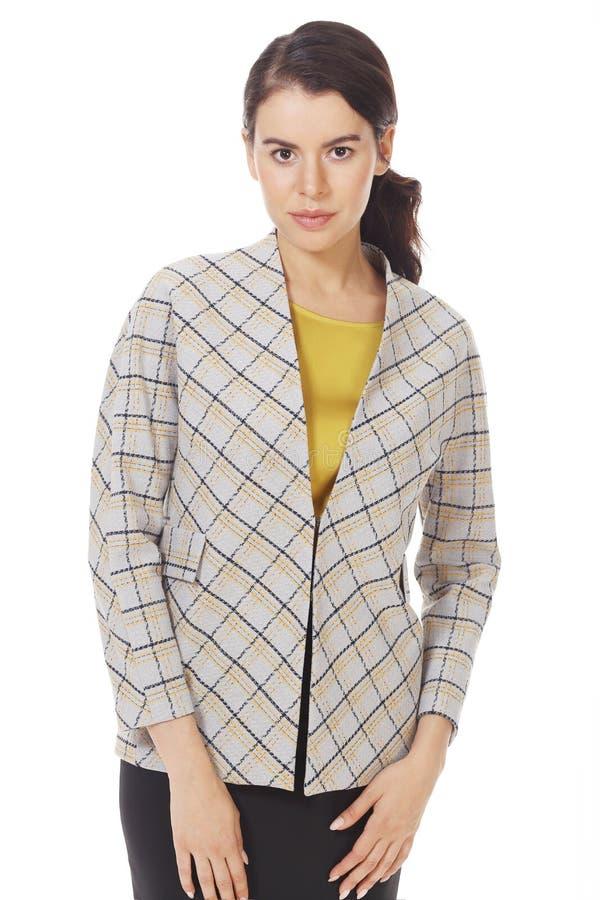 Une femme d'affaires de Brunette portant une veste à carreaux officielle ferme photo photographie stock