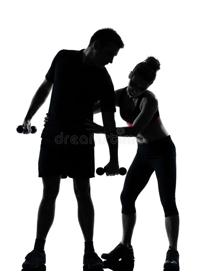 Une femme d'homme de couples exerçant la forme physique de séance d'entraînement photo stock