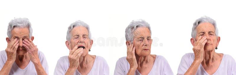Une femme plus âgée avec des yeux, des lèvres, le nez et des oreilles de douleur photographie stock