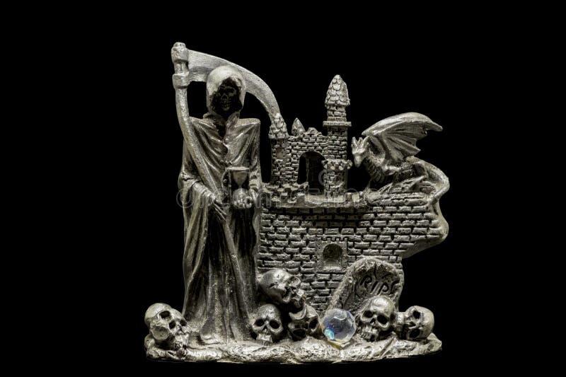 Une figurine en métal de moissonneuse photos stock