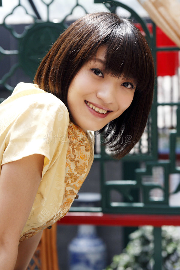 Une fille chinoise avec un sourire. photographie stock