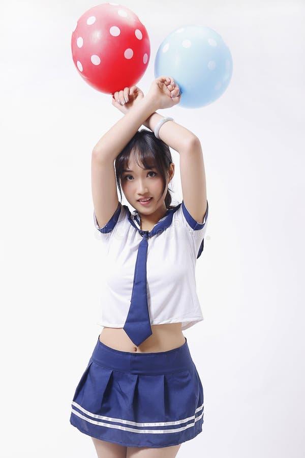 Une fille et un ballon deux naïfs photos stock