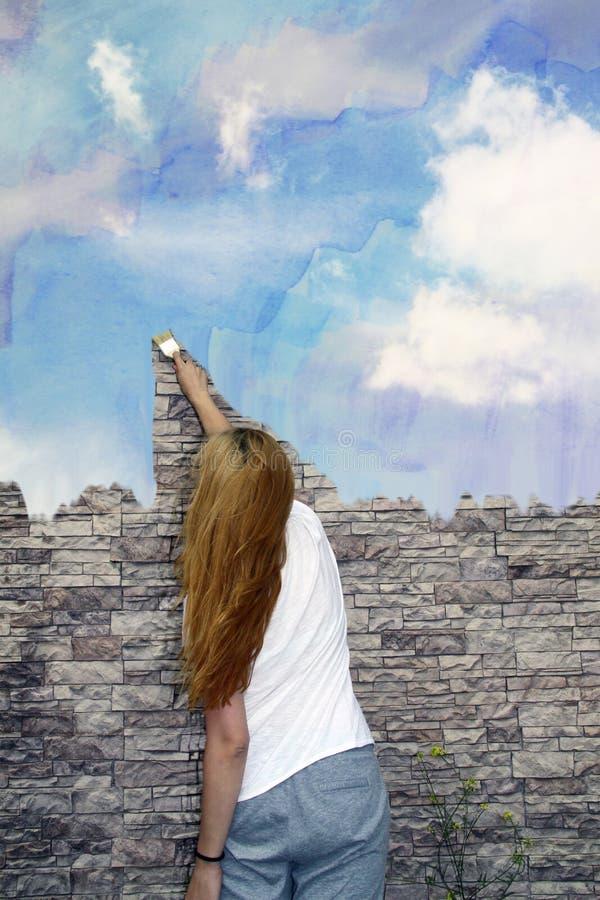une fille peint un ciel d 39 aquarelle sur un mur en pierre photo stock image 81446950. Black Bedroom Furniture Sets. Home Design Ideas
