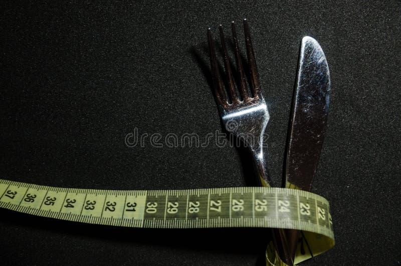 une fourchette avec la bande de mesure image libre de droits