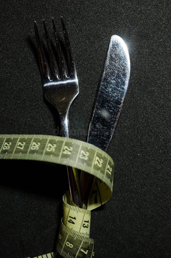 une fourchette avec la bande de mesure image stock