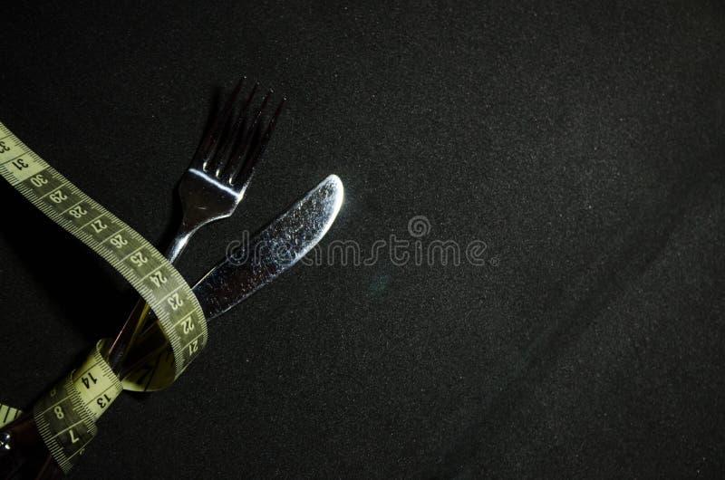 une fourchette avec la bande de mesure photo libre de droits