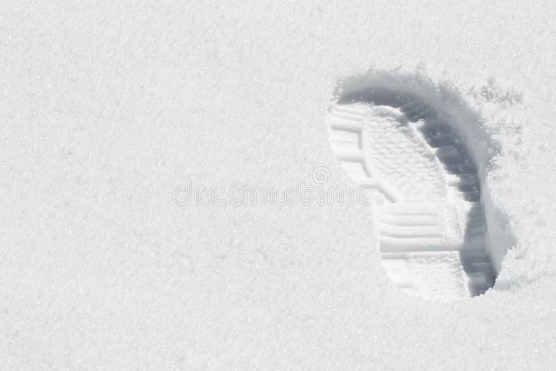 Une gaine d'empreinte de pas dans la neige photo libre de droits