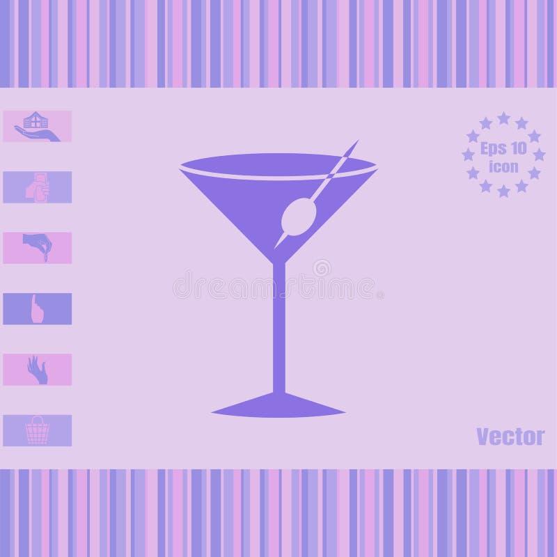 Une icône en verre avec un cocktail et une olive photo stock