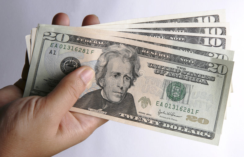 Une main avec la devise des USA photo libre de droits