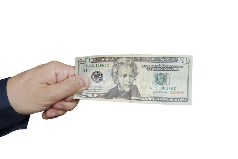 Une main tenant 20 factures image stock