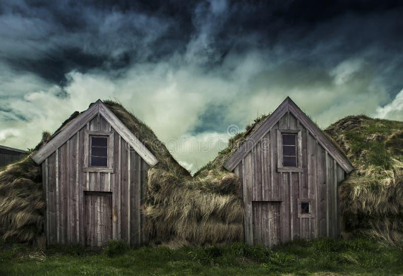Une maison de gazon image libre de droits