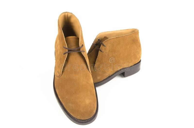 Une paire de chaussures de suède sur le fond blanc image stock