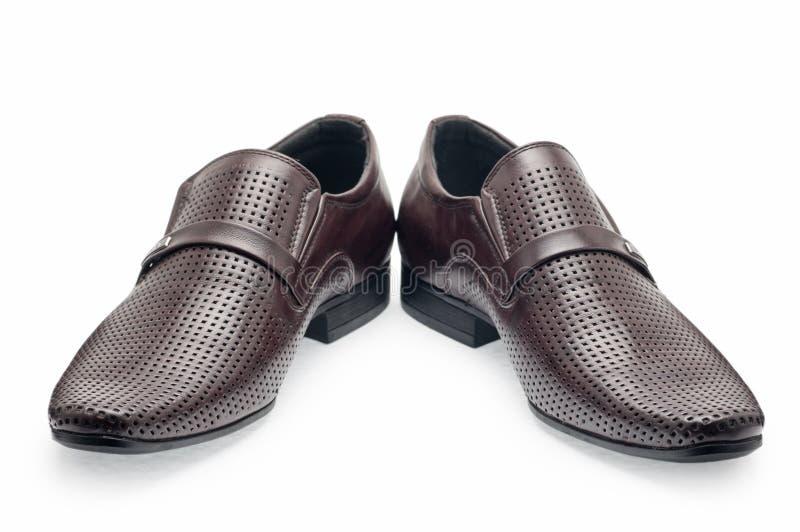 Une paire de chaussures en cuir brunes classiques pour les hommes, sans dentelles photos libres de droits