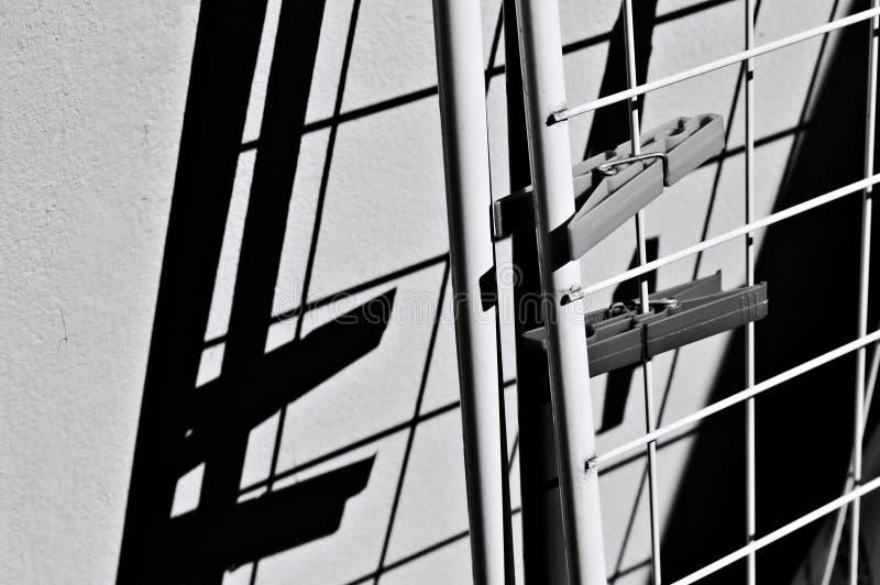 Une paire de espions de tissu attachée au cheval de bataille contre le mur Italie, Europe image libre de droits