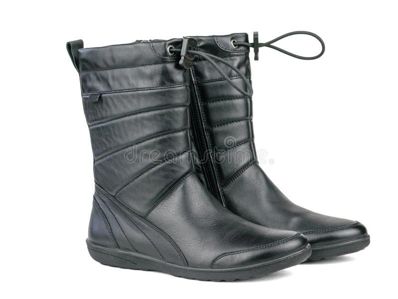 Une paire des bottes en cuir des belles femmes de couleur d'isolement sur le fond blanc photos stock