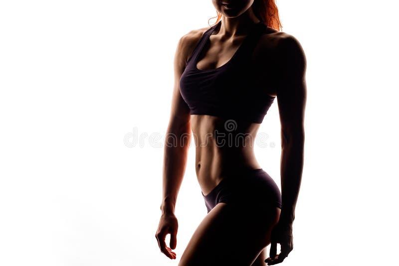 Une partie de corps féminin sportif d'isolement sur le blanc photographie stock