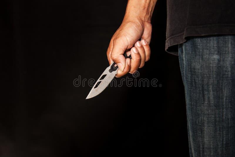 Une personne de tueur avec le dièse images stock