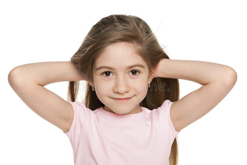 Une petite fille adorable image stock