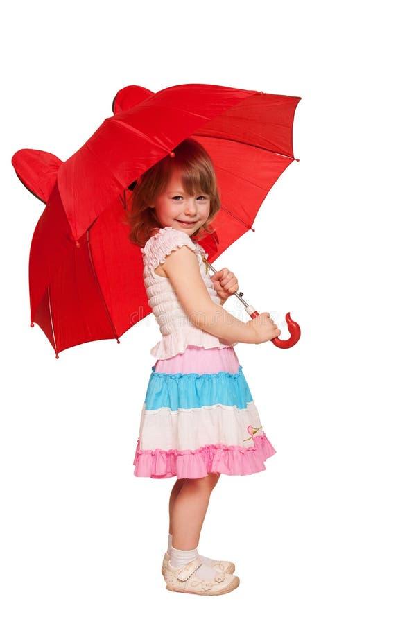 Une petite fille avec un parapluie. D'isolement sur le blanc image stock