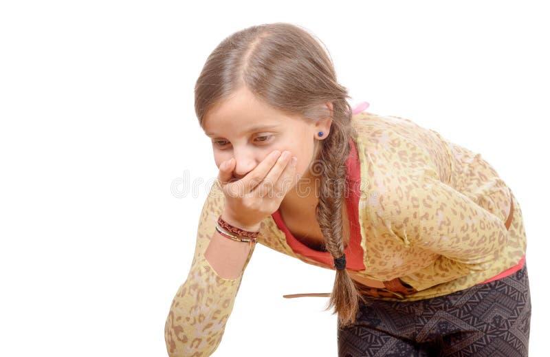 Une petite fille a un mal de ventre photos stock