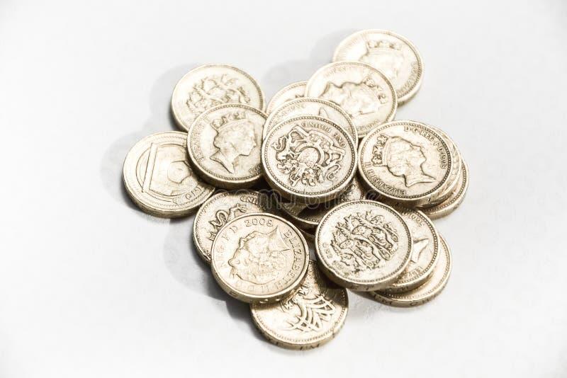 Une pièce de monnaie britannique de livre sterling d'isolement sur le fond blanc - économie BRITANNIQUE de devise de Brexit images libres de droits