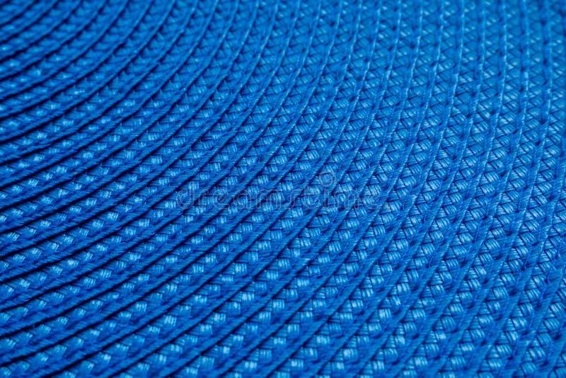 Une pièce de tapis tissé rond bleu de textile Fond abstrait, foyer s?lectif photos stock