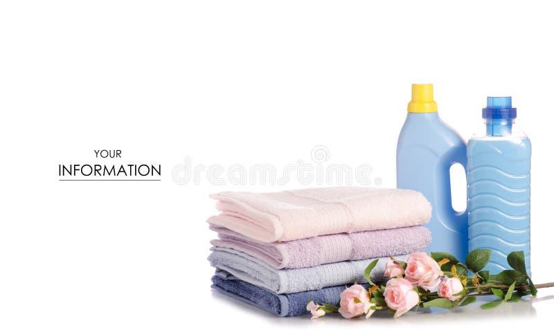 Une pile de serviettes fleurissent le modèle liquide de détergent de blanchisserie de conditionneur d'adoucissant photo stock