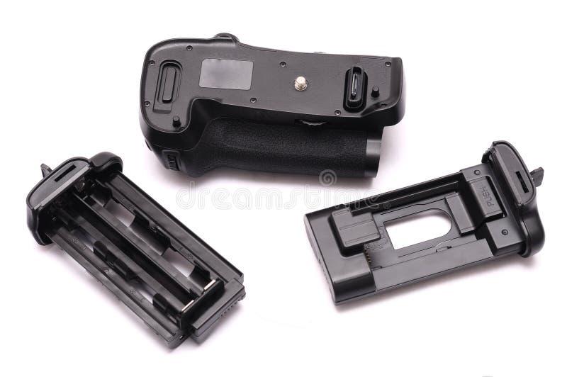 Une poignée verticale numérique d'appareil-photo réflexe de lentille simple avec des plateaux de batterie images libres de droits
