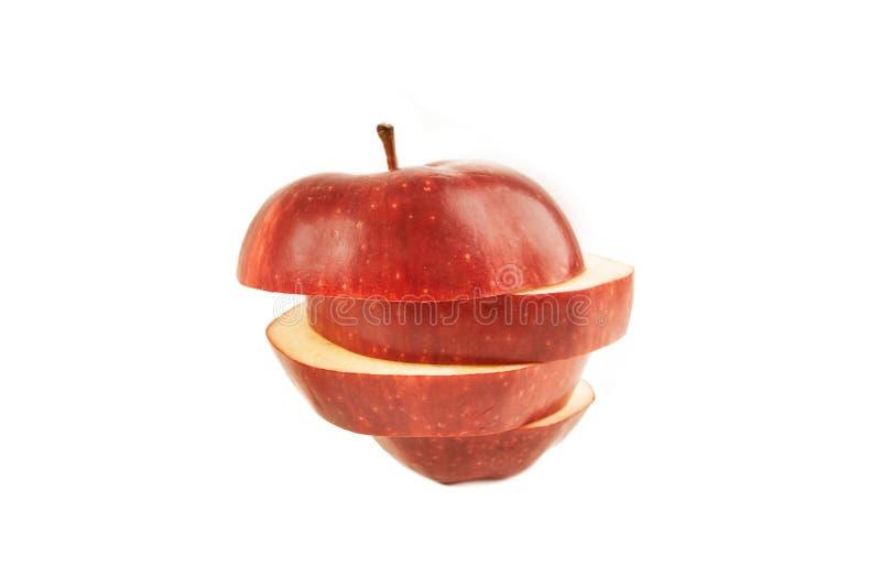 Une pomme cuted dans les tranches images stock