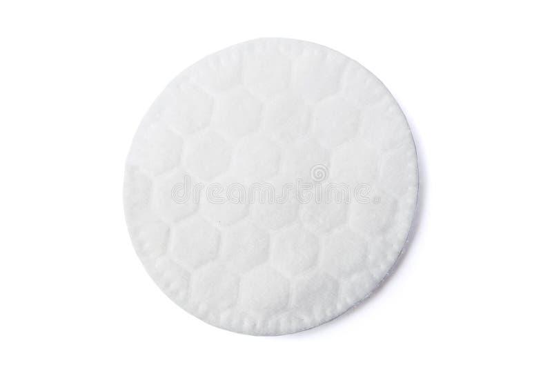 Une protection cosmétique de coton rond sur le blanc images stock