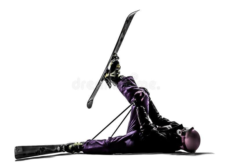 Une silhouette blessée en baisse de ski de skieur de femme photographie stock