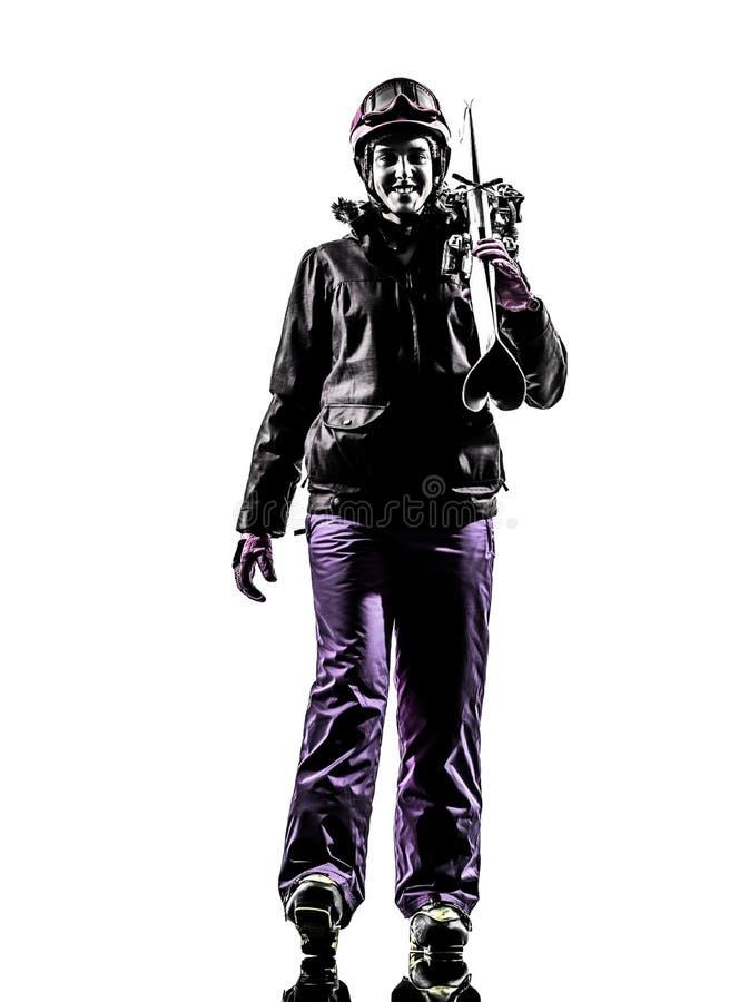 Une silhouette de marche de skieur de femme photos libres de droits