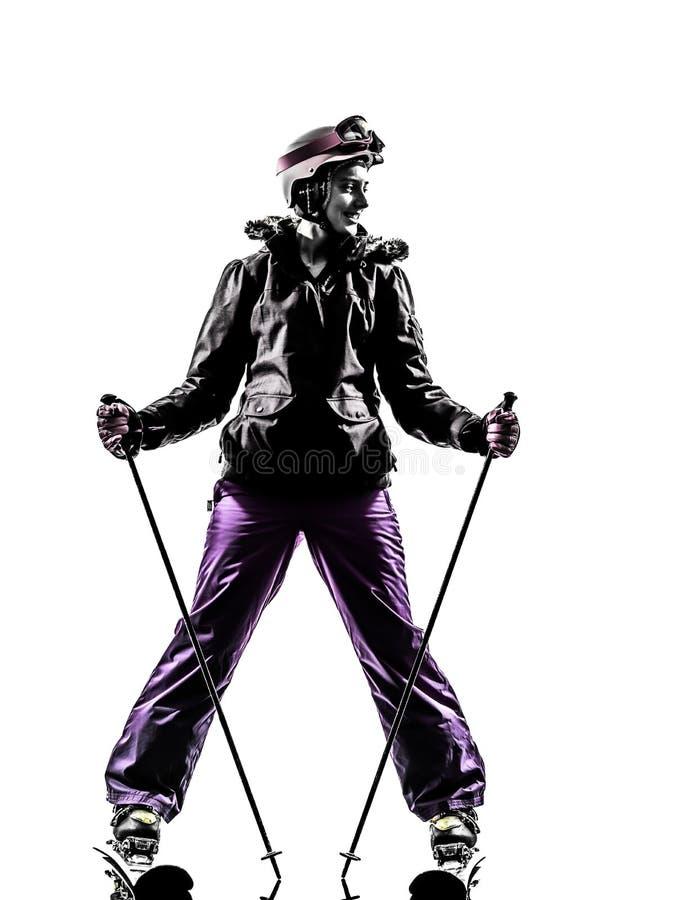 Une silhouette de repos de skieur de femme images stock