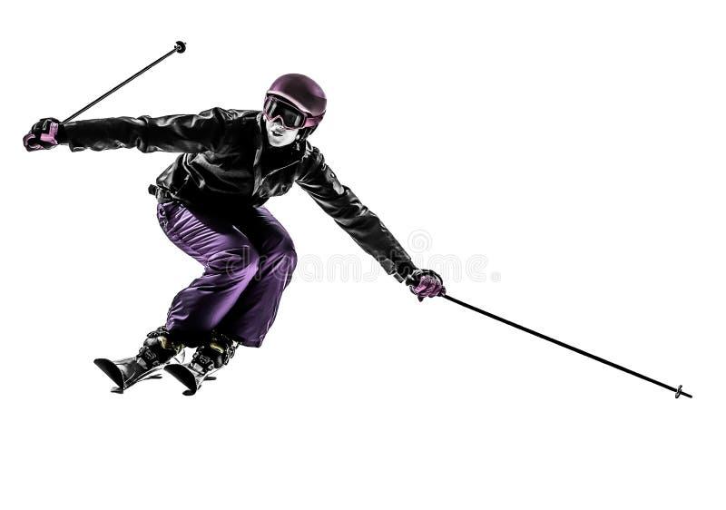 Une silhouette slaloming de ski de skieur de femme photos libres de droits