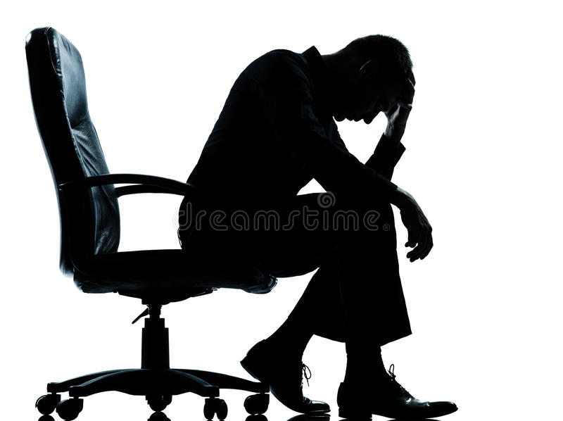 Une silhouette triste fatiguée de désespoir d'homme d'affaires photos libres de droits