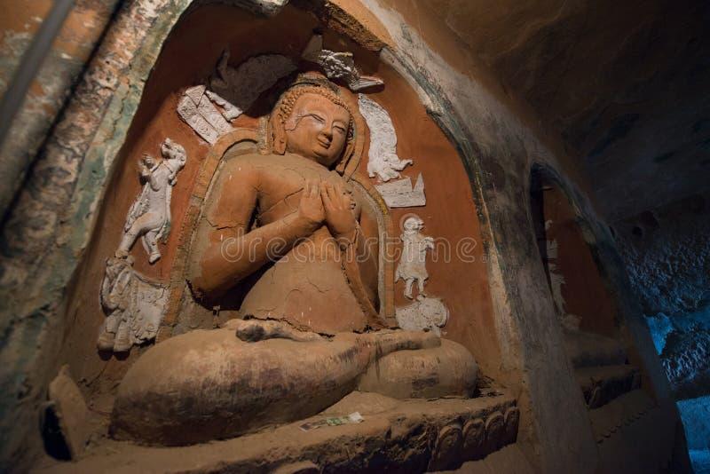 Une statue de Bouddha dans le temple de Mati Si, a également appelé le temple de Hoof de Horse's dans les cavernes de roche, Suna photo libre de droits