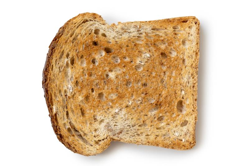 Une tranche simple de pain grillé de blé entier d'isolement sur le blanc d'en haut photo stock