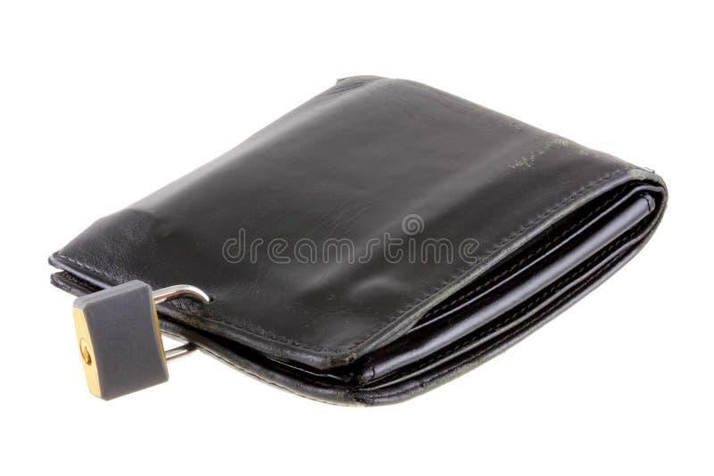 Une vieille pochette en cuir noire avec un blocage de garniture image stock