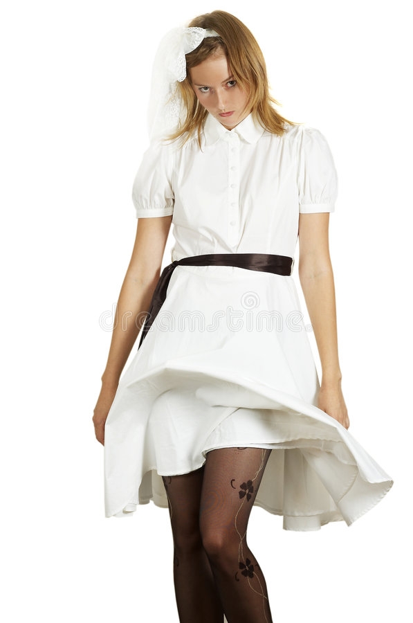 Uneasiness. The beautiful girl in a white dress stock image