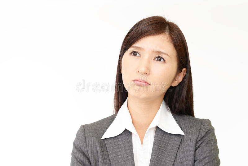 Uneasy Asian business woman stock photos