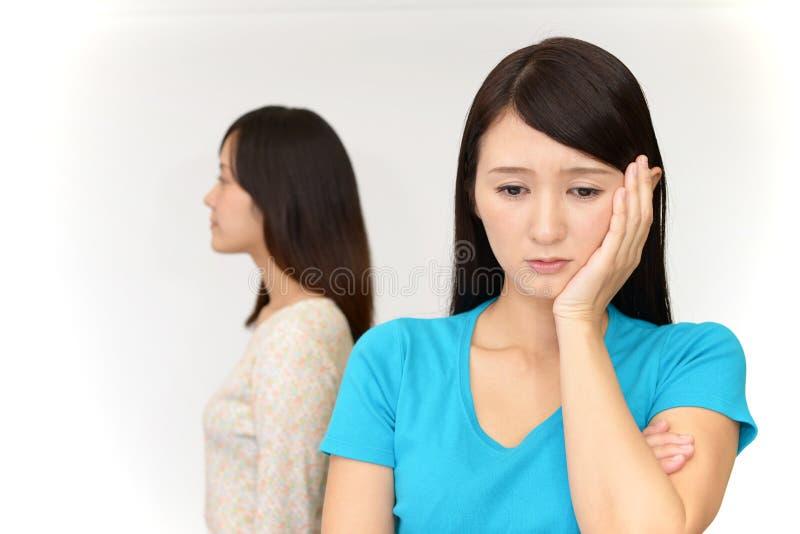 Uneasy Asian women royalty free stock photo
