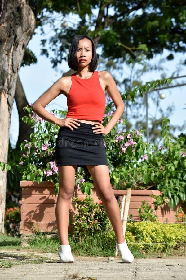 Unemotional Młoda Mniejszościowa osoby pozycja zdjęcie royalty free