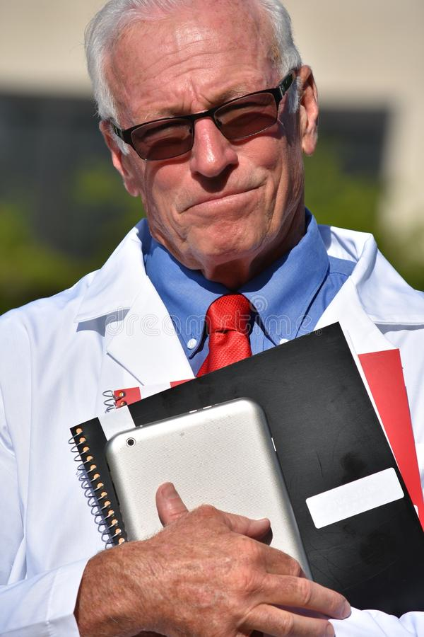 Unemotional Senior Male Medic At Hospital. A retired senior adult male royalty free stock photo