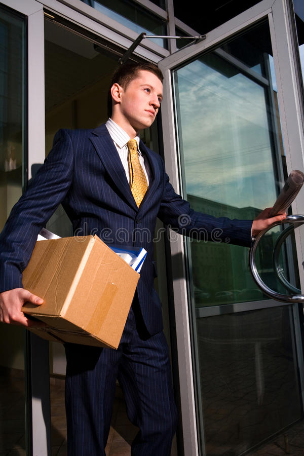 Unemployed manager leaving business center royalty free stock image