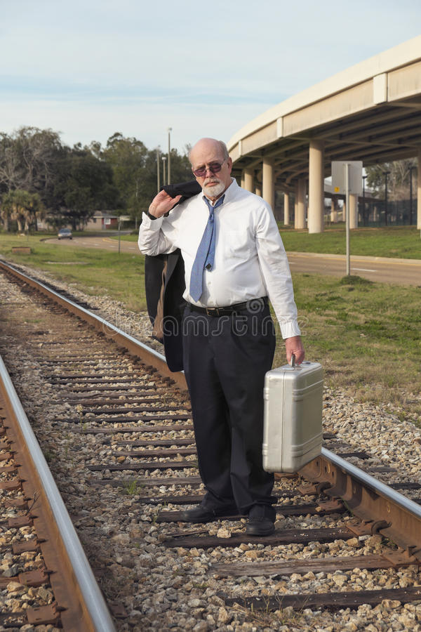 Unemployed Senior Businessman Walks Railroad Tracks Stock Image