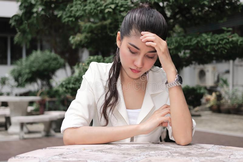 Unemployed stressed young Asian business woman in formal cloathes covering face with hands. Failure and layoff concept royalty free stock photos