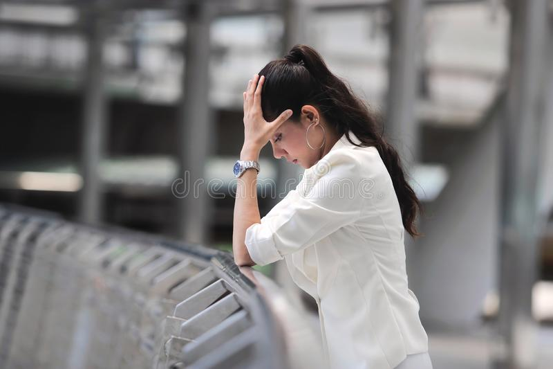 Unemployed stressed young Asian business woman in formal cloathes covering face with hands. Failure and layoff concept stock photos