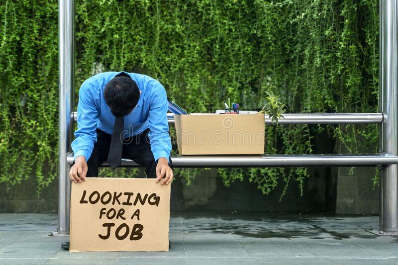 Unemployed worker hold text of looking for a job royalty free stock photography