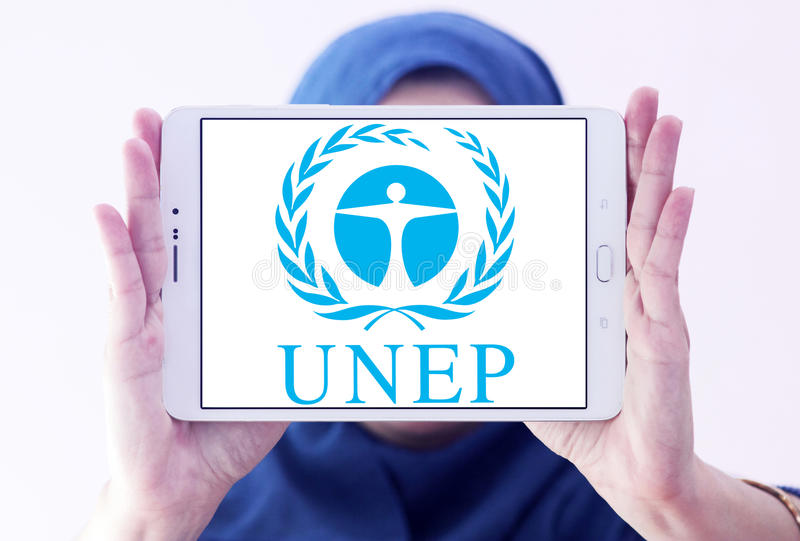UNEP , United Nations Environment Programme logo. Logo of UNEP , United Nations Environment Programme on samsung tablet holded by arab muslim woman. UNEP is an stock images